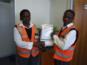 June 2015 | Proud Nomvuyo George, employee of Khuthele Management Services for receiving the employee of the month award and Section Leader Phumlille Dwane